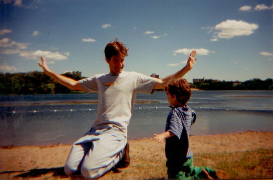 Matt Guidry and Caleb Guidry as a child on the beach with their arms outstretched