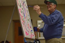 Participant painting in Upstream Arts' Art of Retirement class