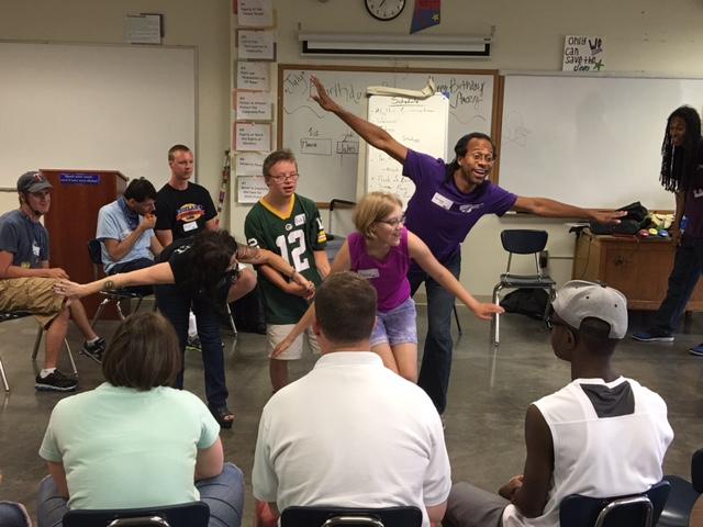 Participants dancing in an Upstream Arts classroom