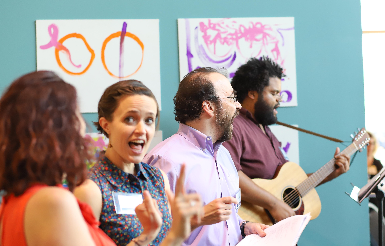 Teaching Artists singing and ASL interpreting.
