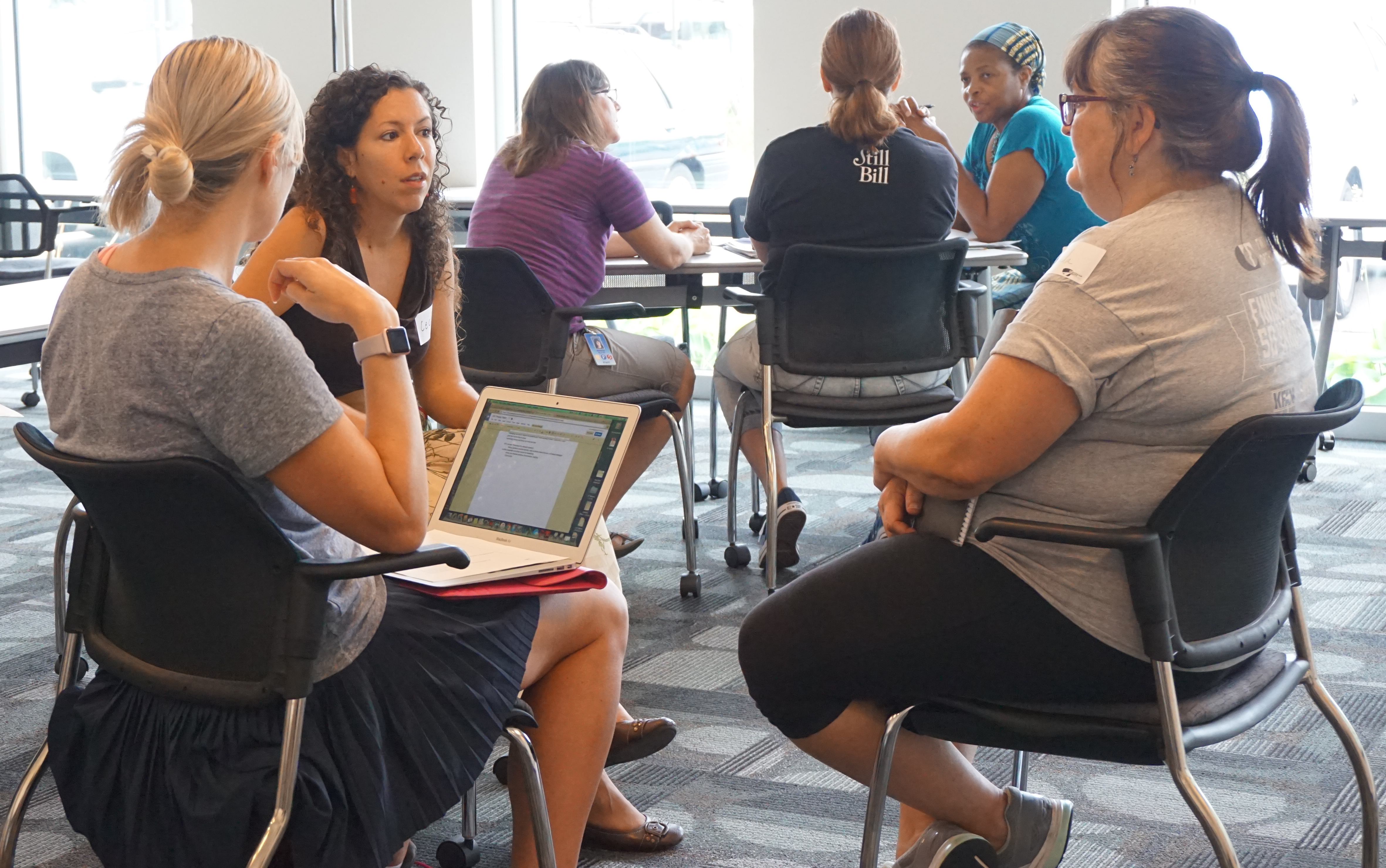 Participants in small group discussions at a Propay class.