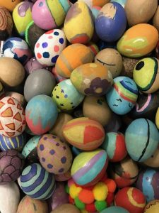 A pile of multicolored painting eggs.
