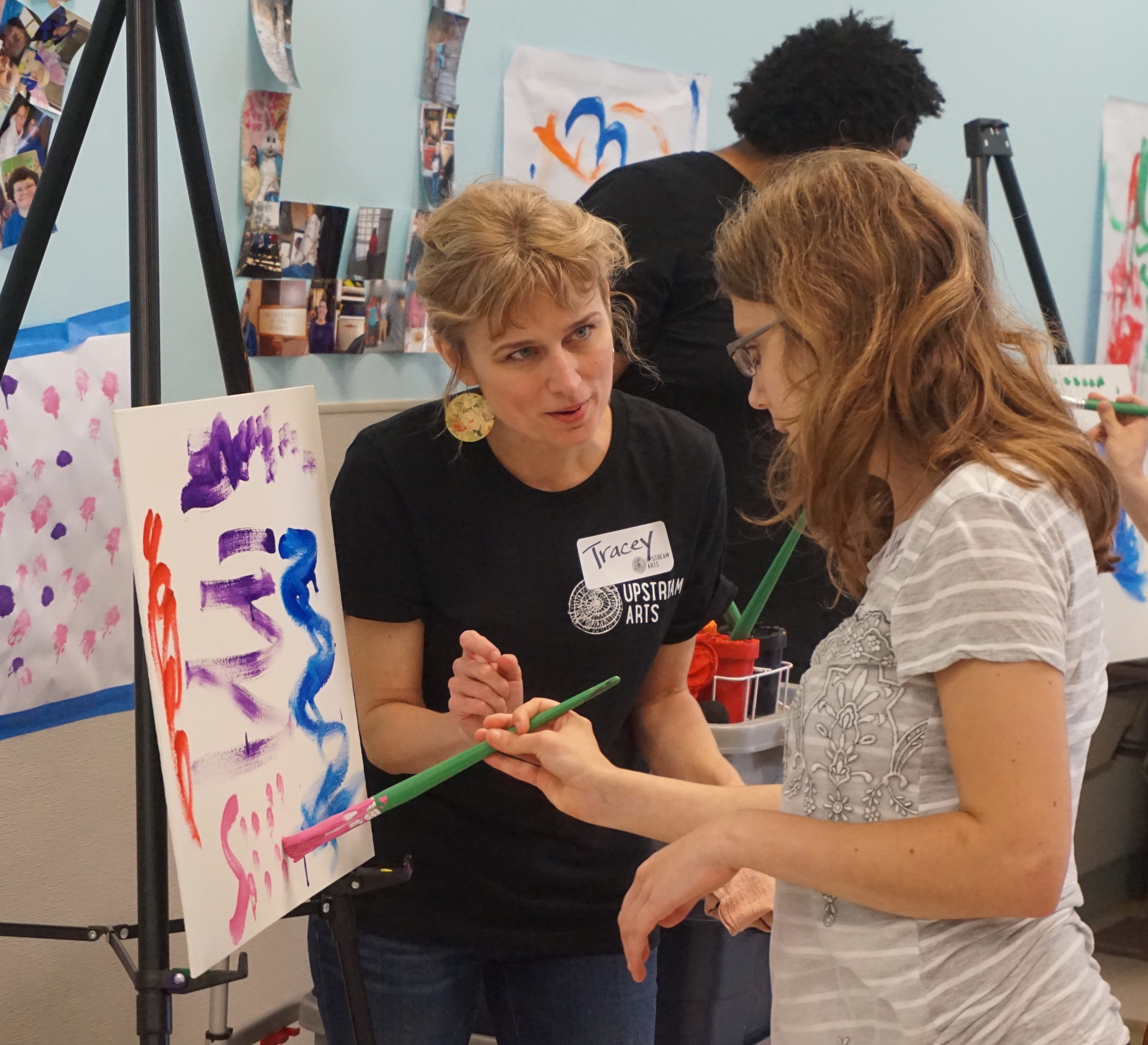 Upstream Arts Teaching Artist and Participant paint together.