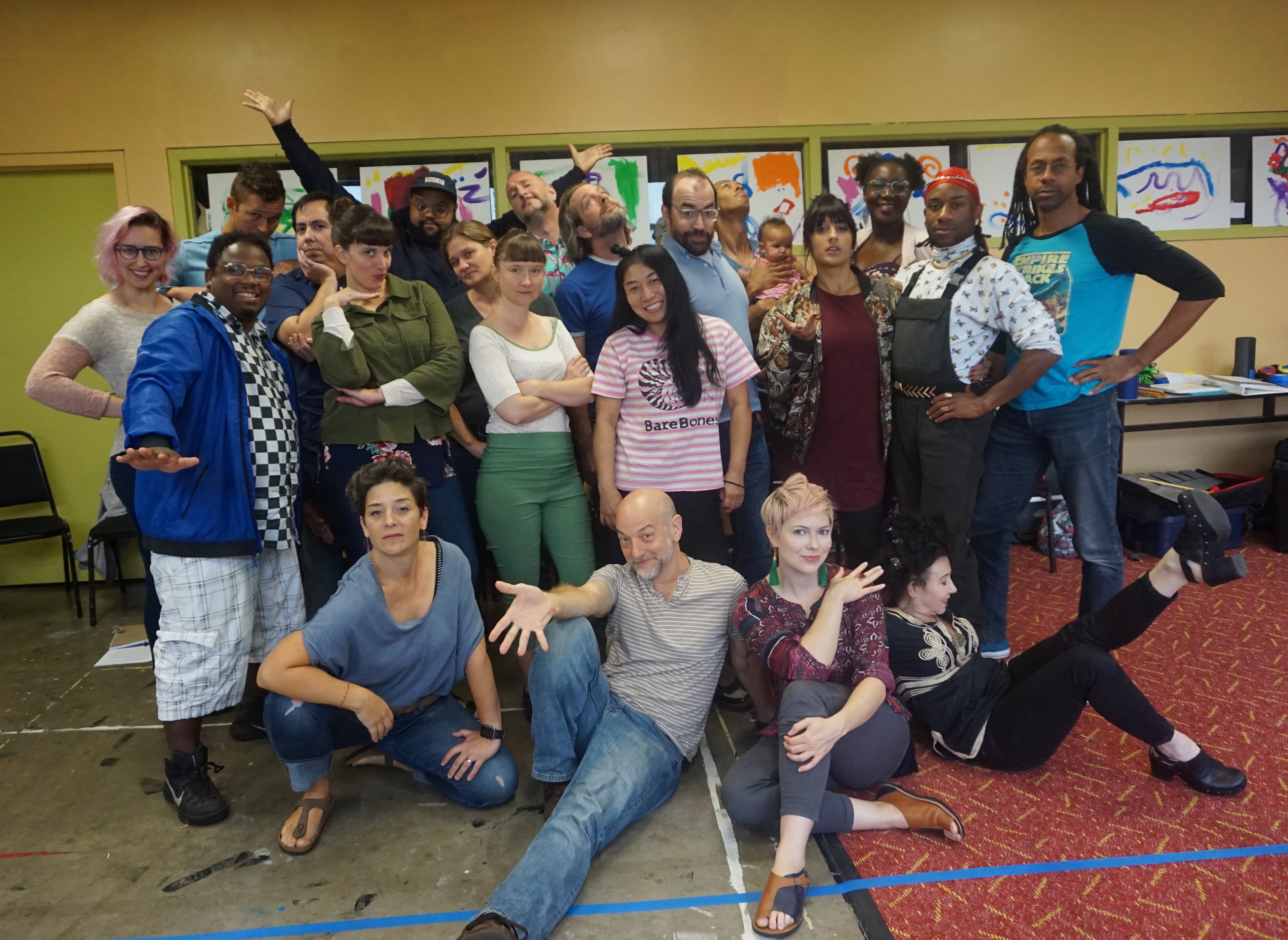 Group photo of Upstream Arts Staff and Teaching Artists in our colorful office.